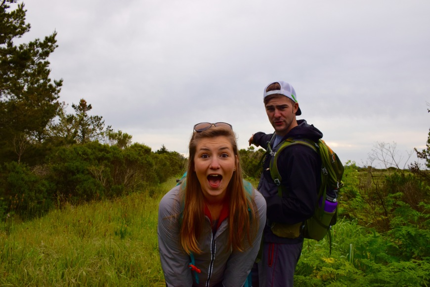 Couple making funny faces on a hike in Santa Cruz