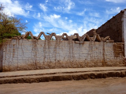 Mud wall architecture and blue skies in San Pedro de Atacama