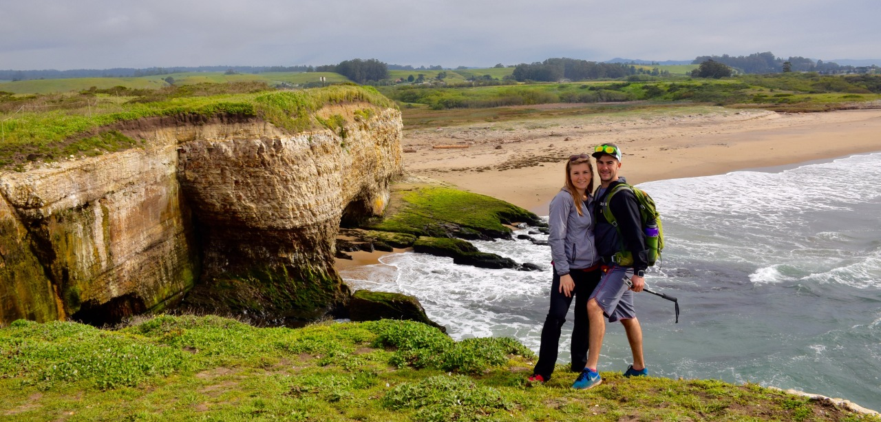 Active and healthy couple hiking on ocean cliffs
