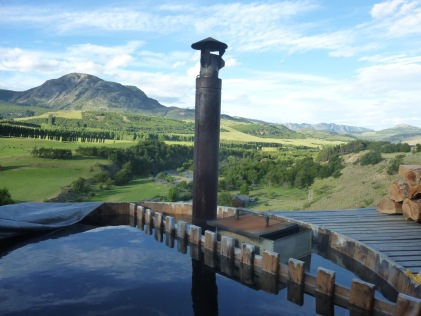Wood burning hot tub at a fishing lodge in Patagonia chile that overlooks a valley