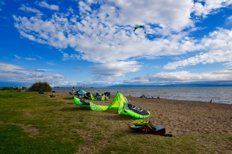 Kite surfing kits on the sand waiting to be out onto the ocean