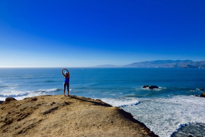 Stretching on the edge of a cliff overlooking the ocean