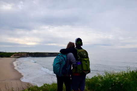 Couple enjoying the ocean view together after a sea cliff hike