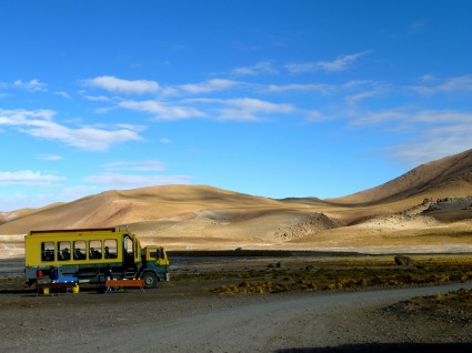 Awesome adventure touring mobile parked in the Atacama Desert on a sunny day