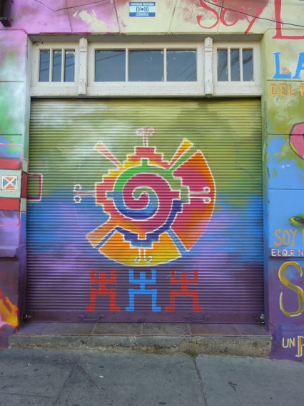 Colorful mural on a garage door in the UNESCO world Heritage site of Valparaiso
