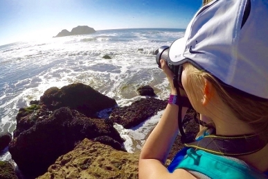 Photographer taking a photo by the ocean in San Francisco