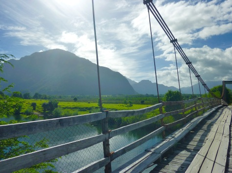 Handmade bridge over a river in rural Coyhaique Chile