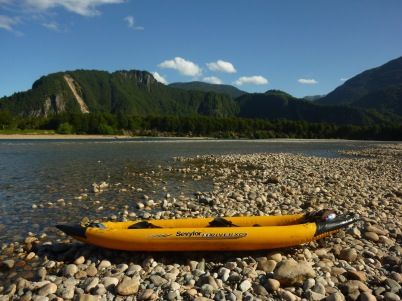 Kayak on a river in Coyaihque Chile with mountains in the background