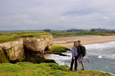 Couple enjoying the ocean and sea cliffs after a hike