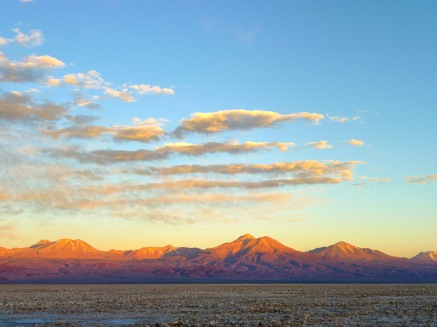 Rainbow sunset shadows cast across mountains in the Atacama desert
