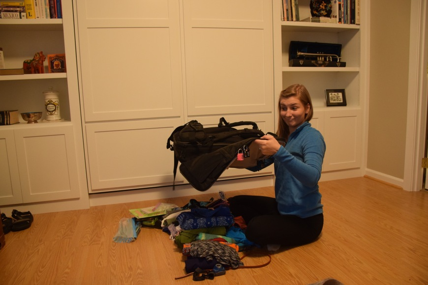 Dumps everything out of the carry-on and begins packing again! Time to use space more efficiently