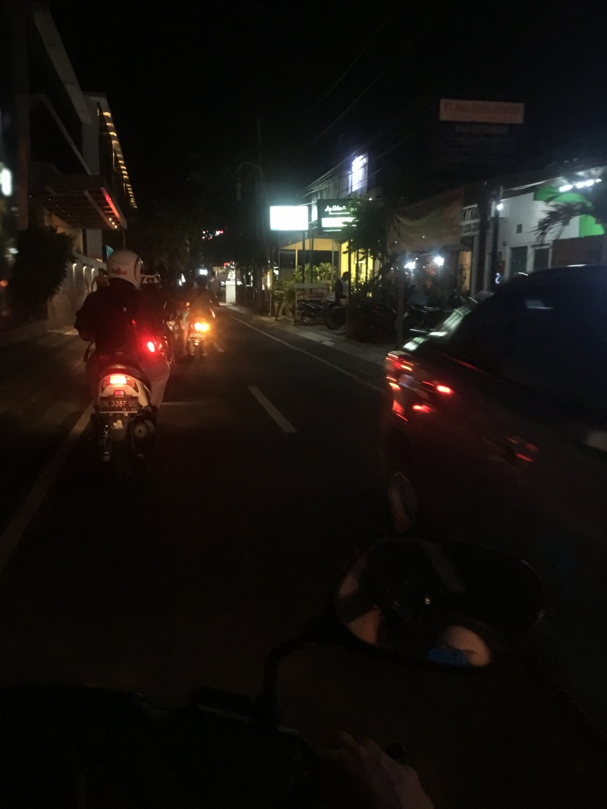 Riding a scooter at night in Bali