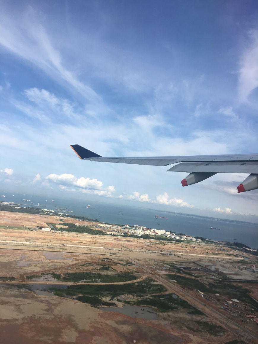 Our plane finally taking off from Singapore to final destination Bali!