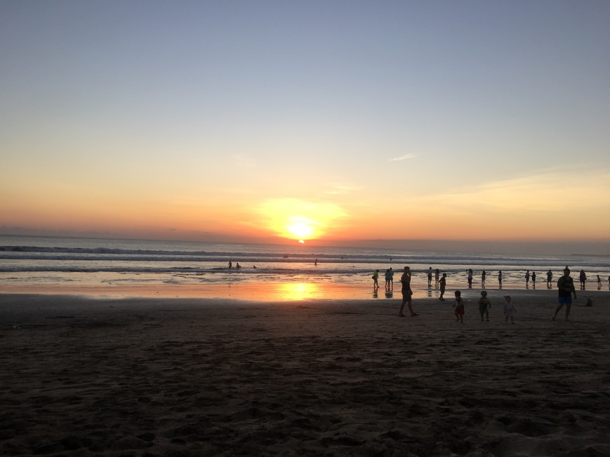 Listening to locals play guitar while watching sunset over the beach in Bali