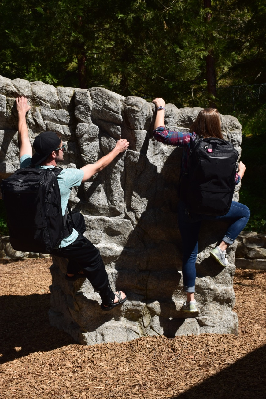 Climbing up a rock wall with our Tortuga Backpacks on