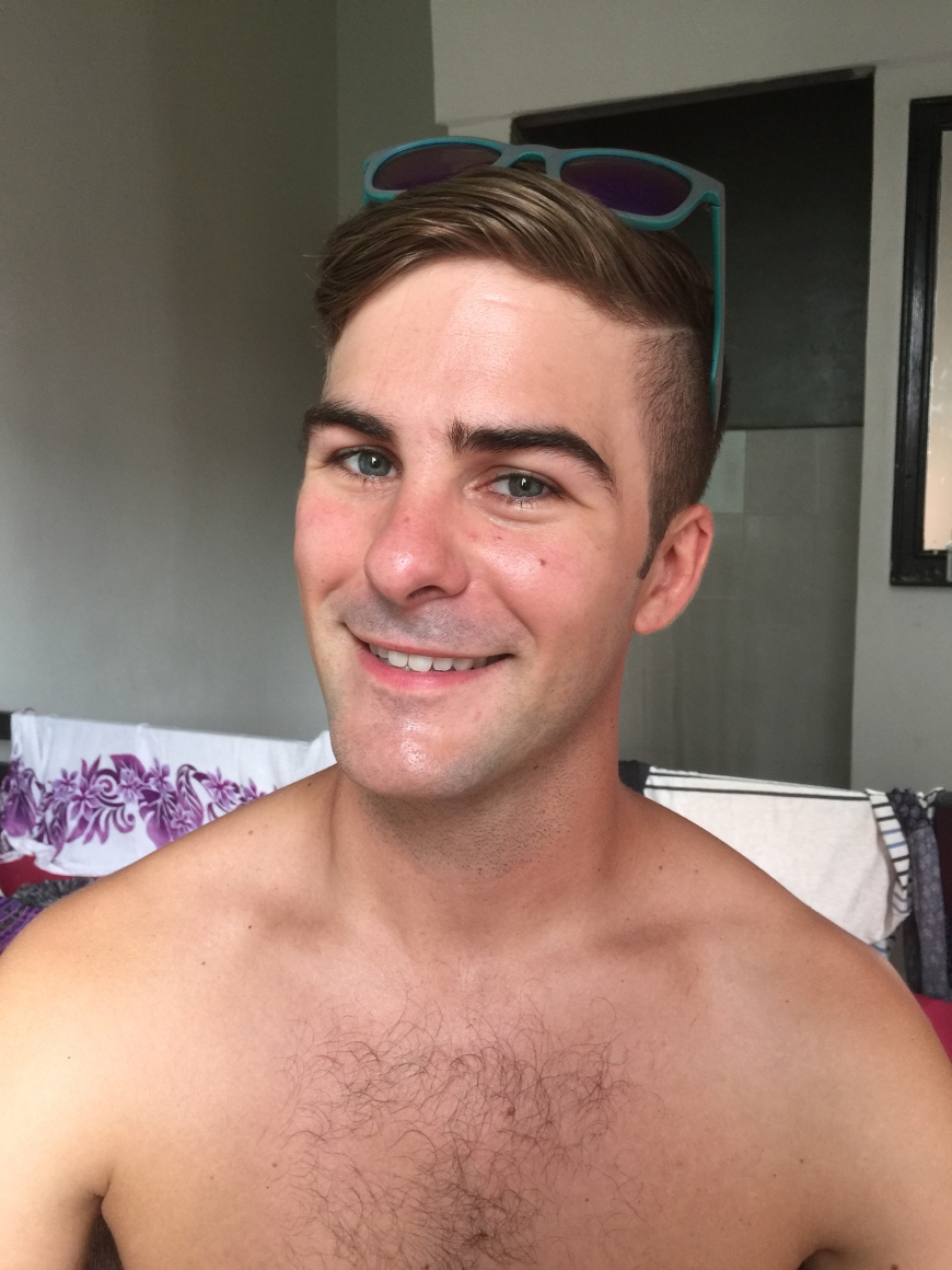 After getting a haircut and shave in Kaula Lumpur, Malaysia