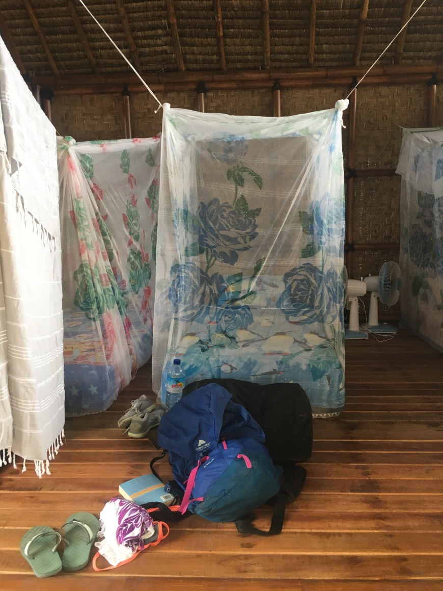 Mosquito nets surrounding twin mattresses in the open air bungalows