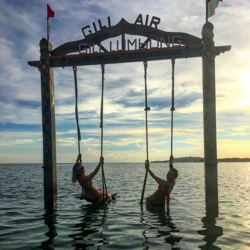 Swinging on the insta-famous swings over the ocean on Gili Air