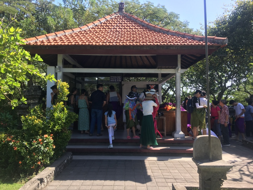 Ticket Counter And Sarong Station At Uluwatu Temple Where Sarongs Are Included In Entrance Fee