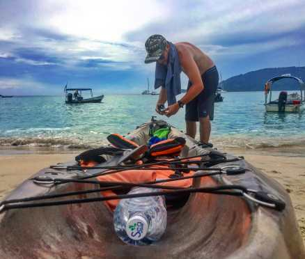 Checking our kayak and getting ready for to paddle around the island of Perhentian Kecil