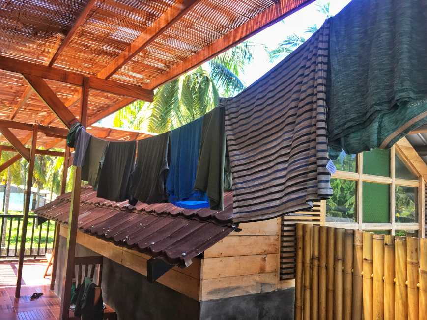 Hanging laundry on our washing line in Thailand after washing it with our Scrubba bag