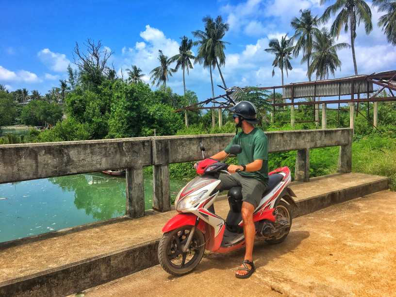 Taking our motorbike out for a spin to Explore the island of Koh Lanta in Southern Thailand on a sunny day