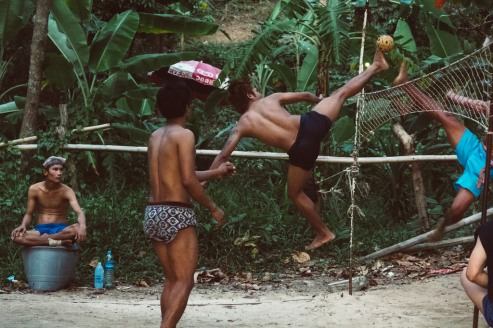 Sepak Takrwa game being played as two men kick the ball over the net