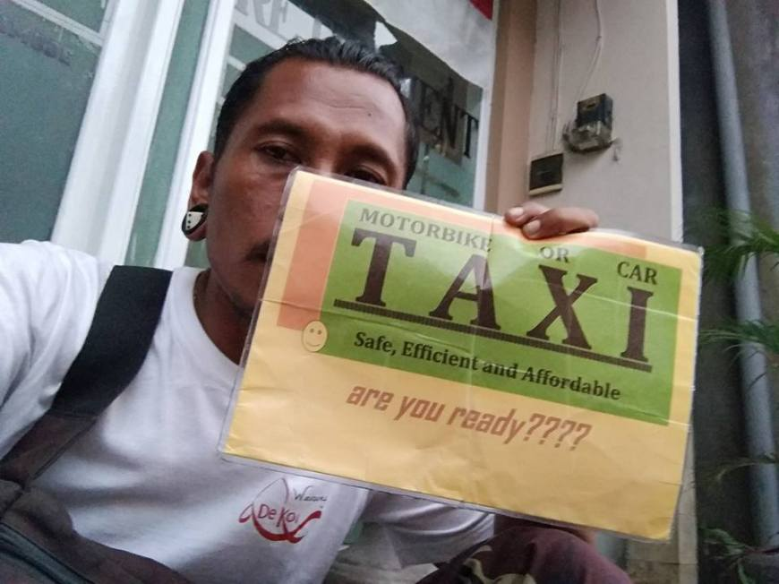Taxi Driver Making A Living