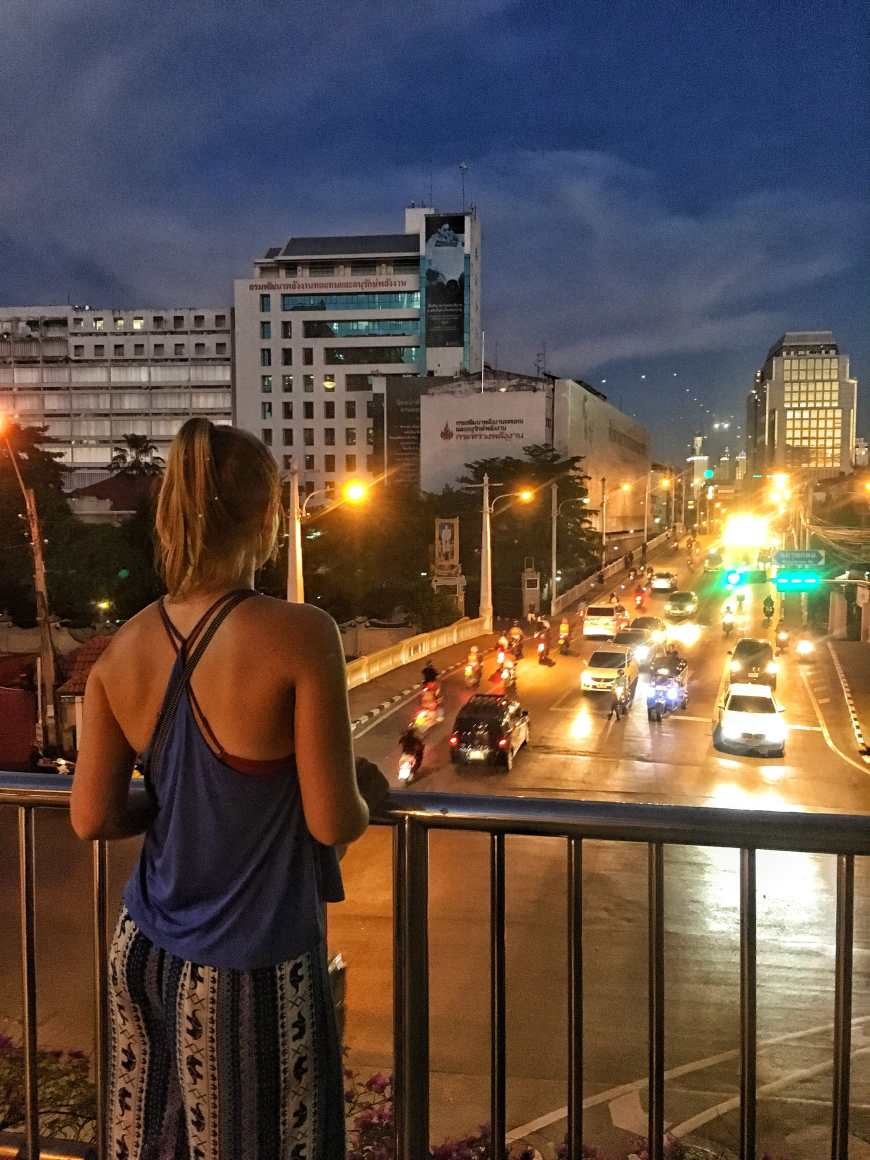 Exploring Bangkok on our feet with an hour walk through the city streets at dusk over pedestrian bridges