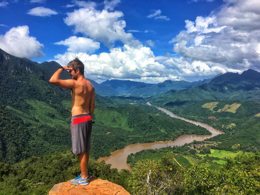Standing on top of the world and taking in the incredible Nong Khiaw viewpoint with mountains and rivers in the distance