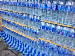 Rows on rows of blue water bottles as we color map our way through Phuket, Thailand