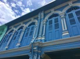 Historic blue building in Old Town Phuket painted Blue during our day of color mapping in Southern Thailand