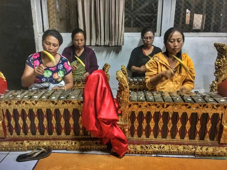 Listening to traditional gamelan music played by women from Remy's village in Tampak Siring, Bali