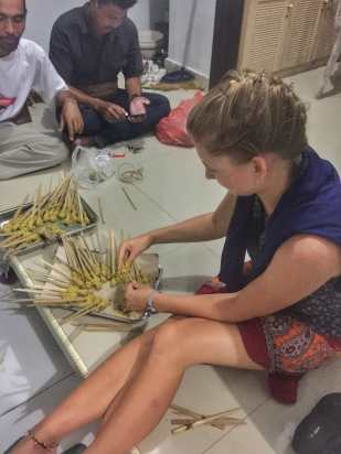 Alli attempting to make Sate Lilit on the night we cooked dinner with 30 locals and friends in Remy's village in Tampak Siring