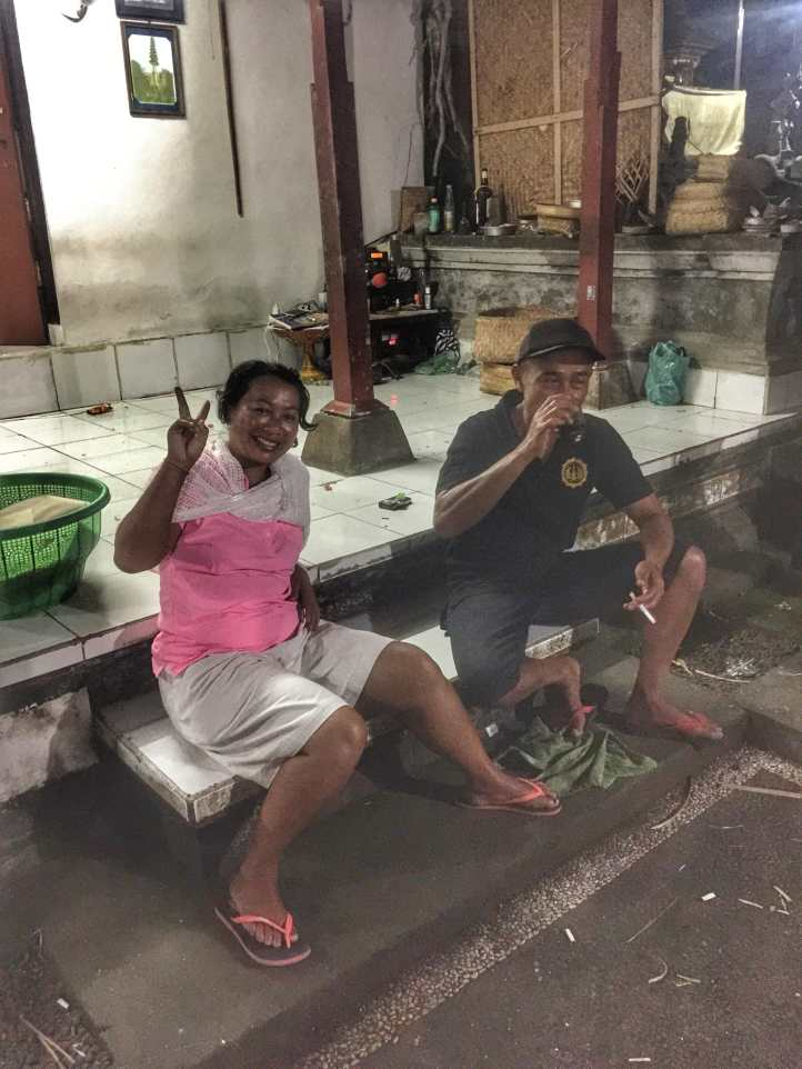 Cooking dinner and drinking with a group of 30 Balinese locals and friends