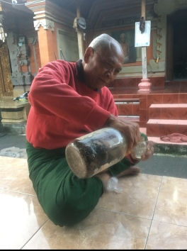 Wayan's father, Ketut, pouring us a glass of Arak (traditional balinese liquor) he's been fermenting for 30 years