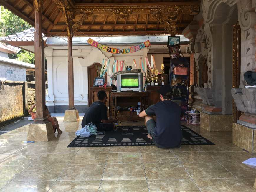 Remy and TJ playing video games on one of the terraces of the family compound