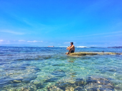 Sitting in the middle of the blue ocean in Candidasa Bali