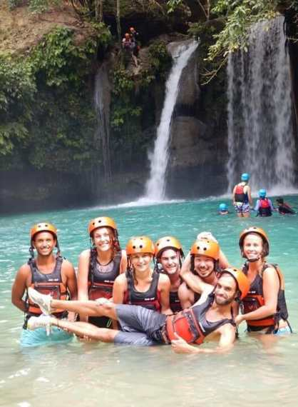 All smiles after jumping the largest cliff jump at Kawasan Falls in Cebu, Philippines