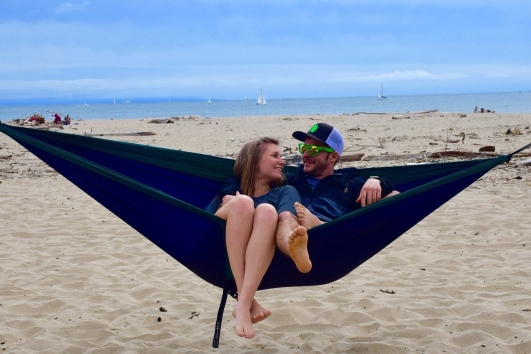 Sitting in our ENO hammock together enjoying the beach