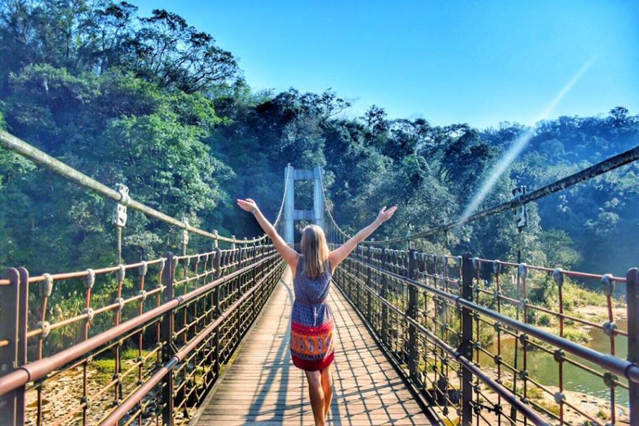 Alli walking across the bridge to get to Shifen waterfall