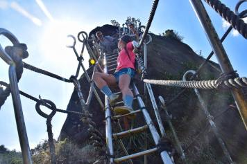 TJ and Alli Hanging on the ladder at pingxi crags