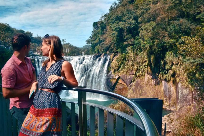 TJ and Alli at Shifen waterfall in Taiwan
