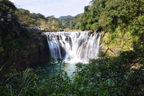 Looking out at Shifen Waterfall in Taiwan with a rainbow