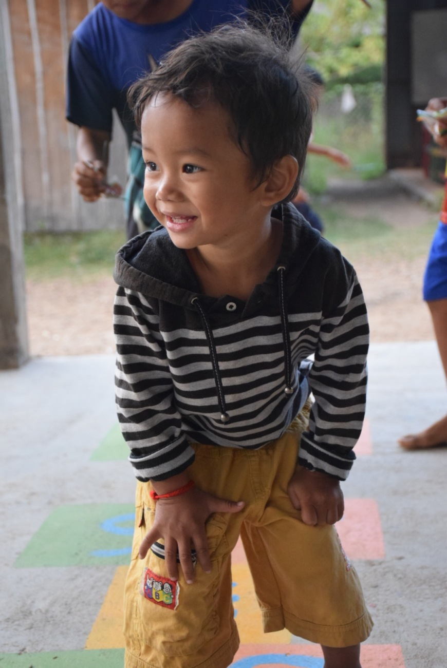 One of our students playing at school in Kratie before English Lessons