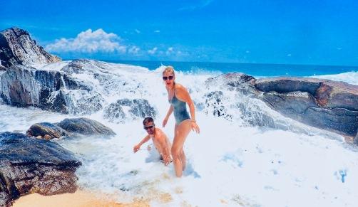 laughing about getting drilled by a wave Unawatuna beach, Sri Lanka