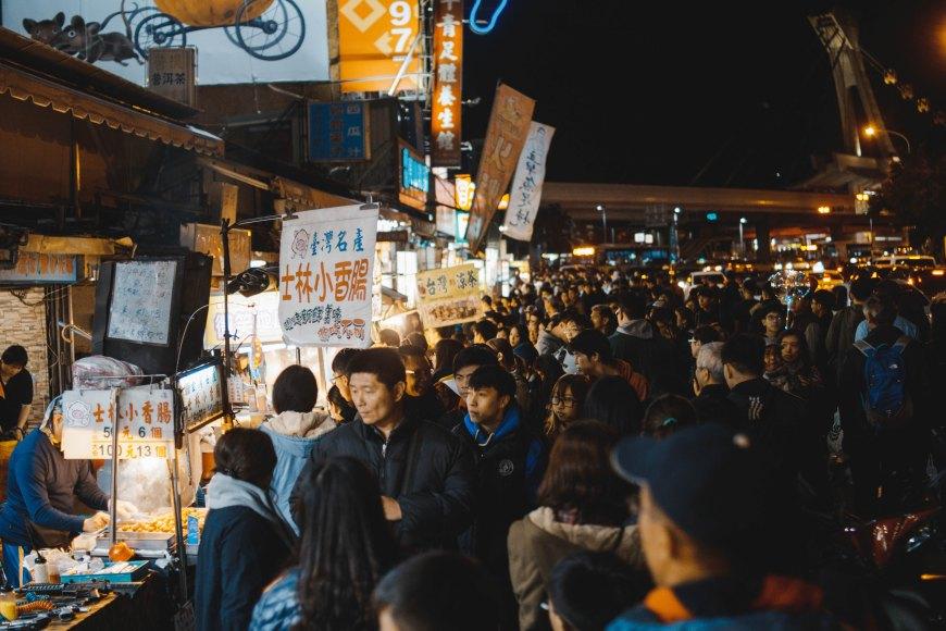 Walking down the street at Shilin Night Market