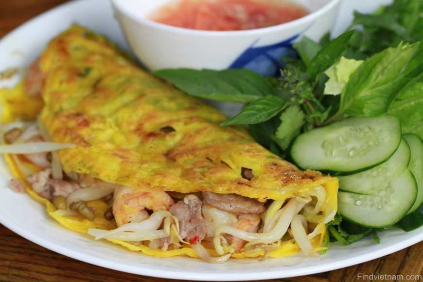 Vietnam's sizling moon crepe known as Banh Xeo stuffed with