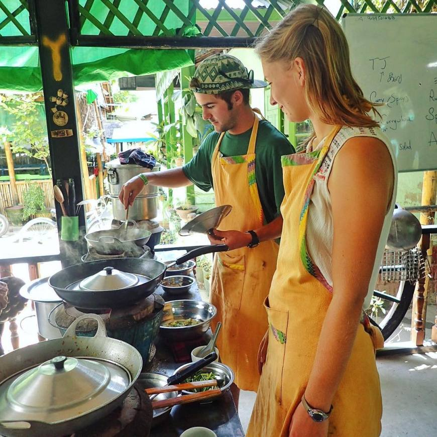 Travel couple enjoying taking a local cooking class in Inle Lake Myanmar