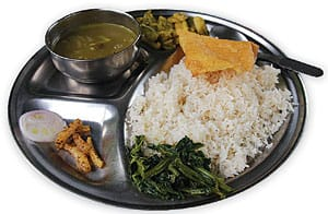 Nepal's staple Dal Bhat dish served on a metal plate